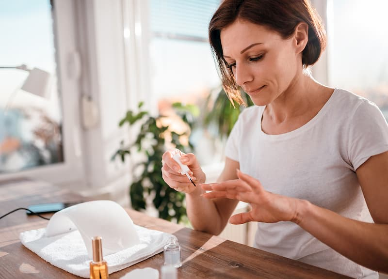 woman doing manicure at home