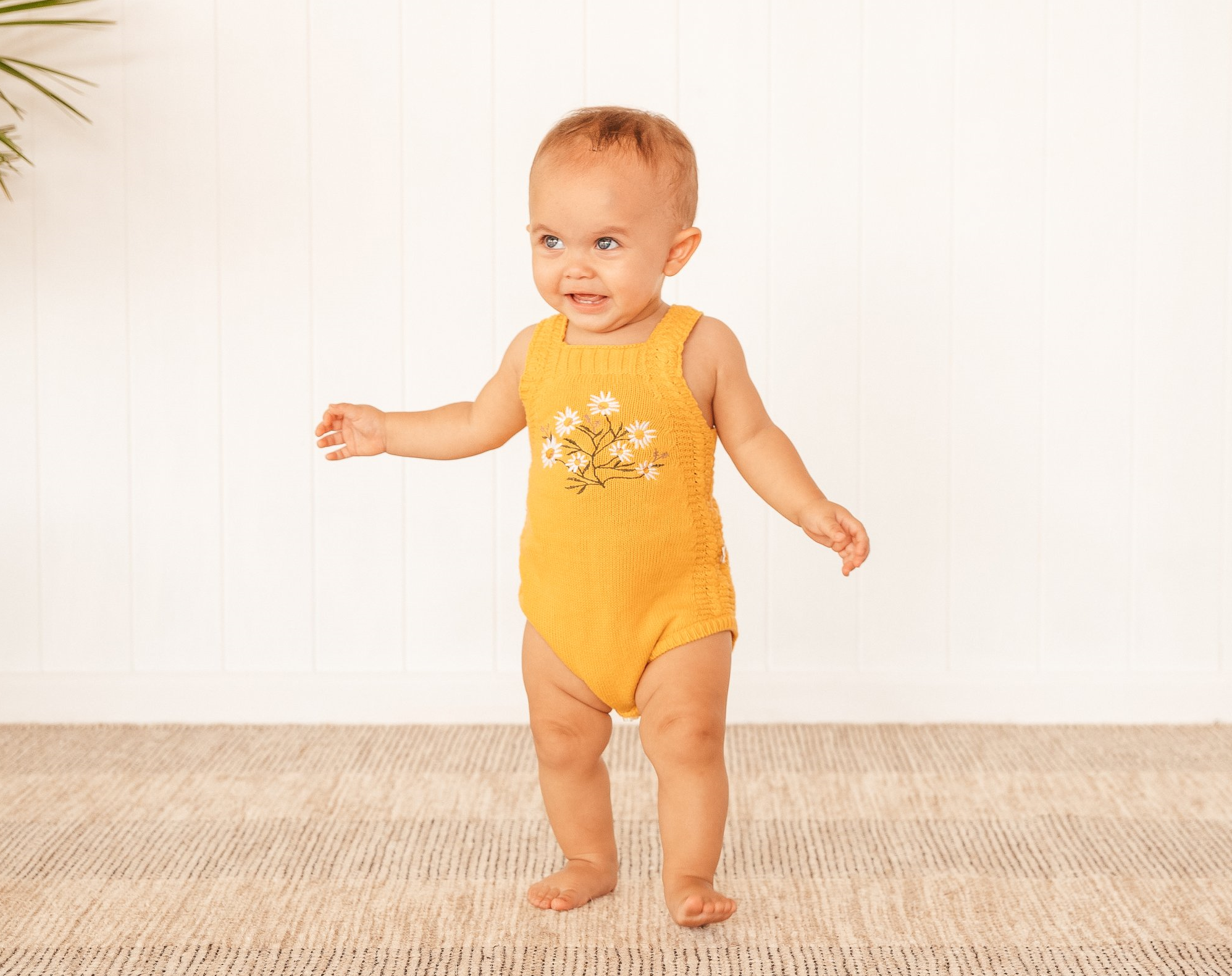 baby girl wearing daisy knitted romper